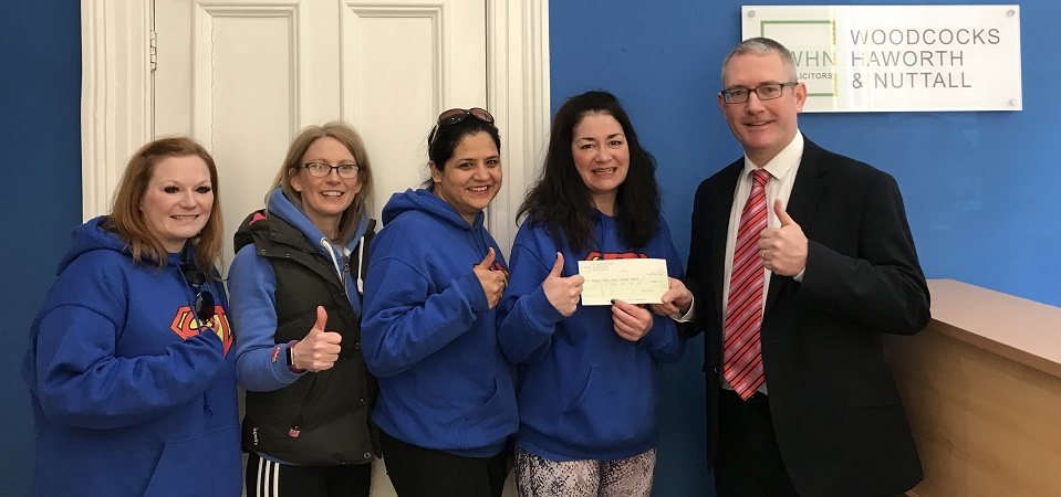 The Joshua Wilson Brain Tumour Charity accepts cheque from WHNs 2018 charity quiz event